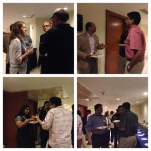 Attendees mingling over dinner